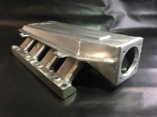 Výroba dílů a doplňků pro závodní a sportovní automobily a motocykly