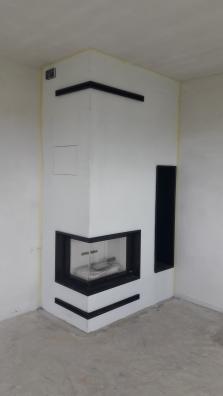 Rohová krbová obestavba v přípravě před finálním obkladem - kamenem, dřevník pro tuto stavbu byl vyráběn přímo na míru.